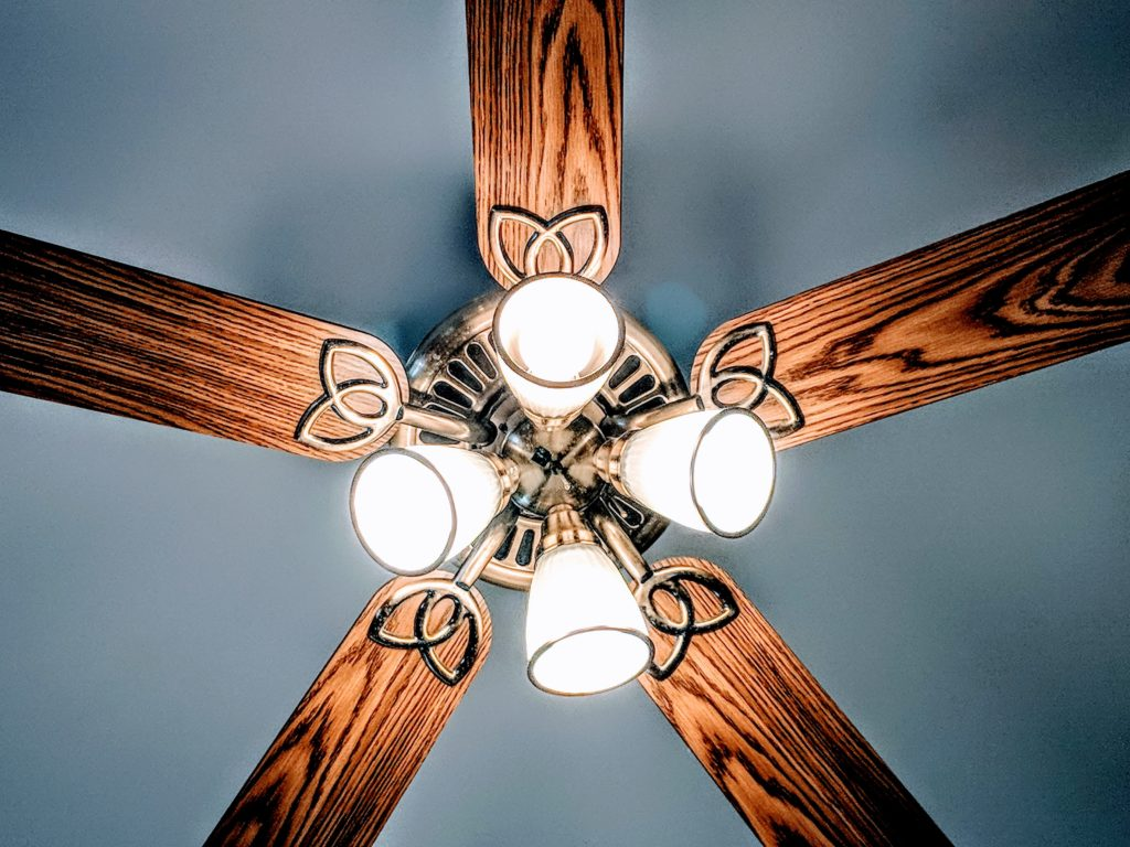 Image of a ceiling fan with four lights.
